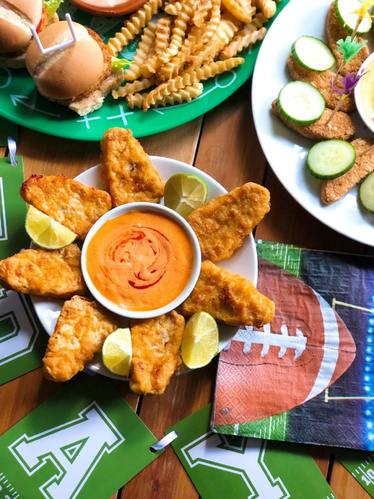 These are the Gardein fishless filets paired with a spicy mayo sriracha sauce and limes