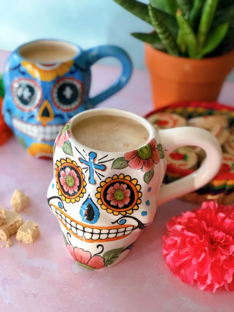 Cheers with a Mexican hot drink also called atol