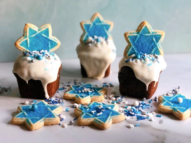 Hanukkah cupcakes with Star of David cookie topper and sprinkles