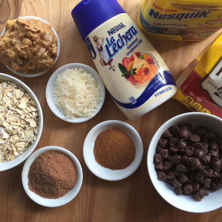 The ingredientes for the chocolate bonbons includes condensed milk, oats, chocolate, sugarless coconut flakes, cinnamon, peanut butter, and semi-sweet chocolate morsels