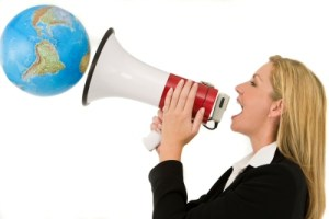 Woman with megaphone shouting to a globe