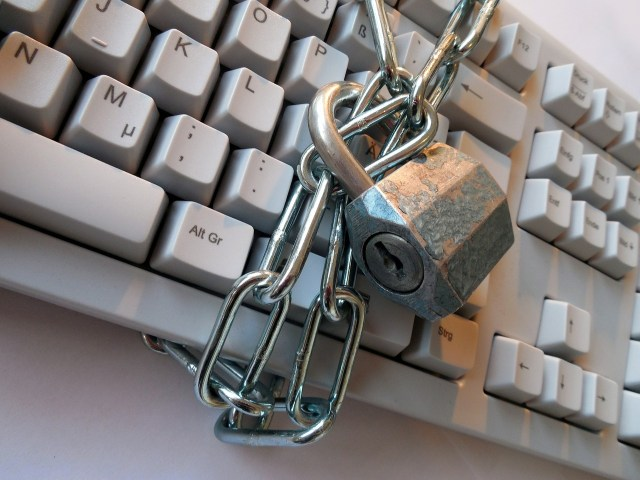keyboard with padlocked chain around it