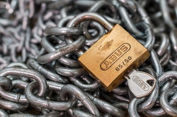 padlock on top of chains