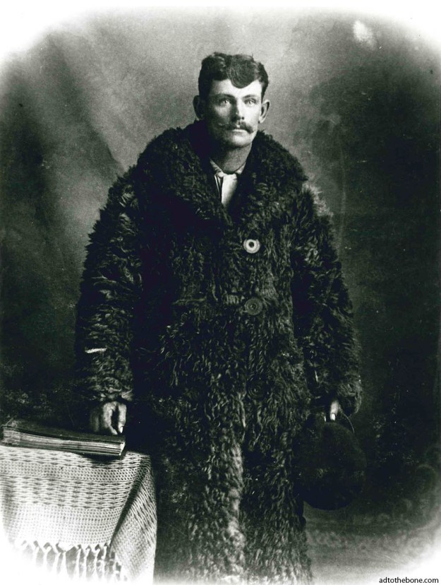 Man in some sort of a fur suit with very large buttons from some time in the past.