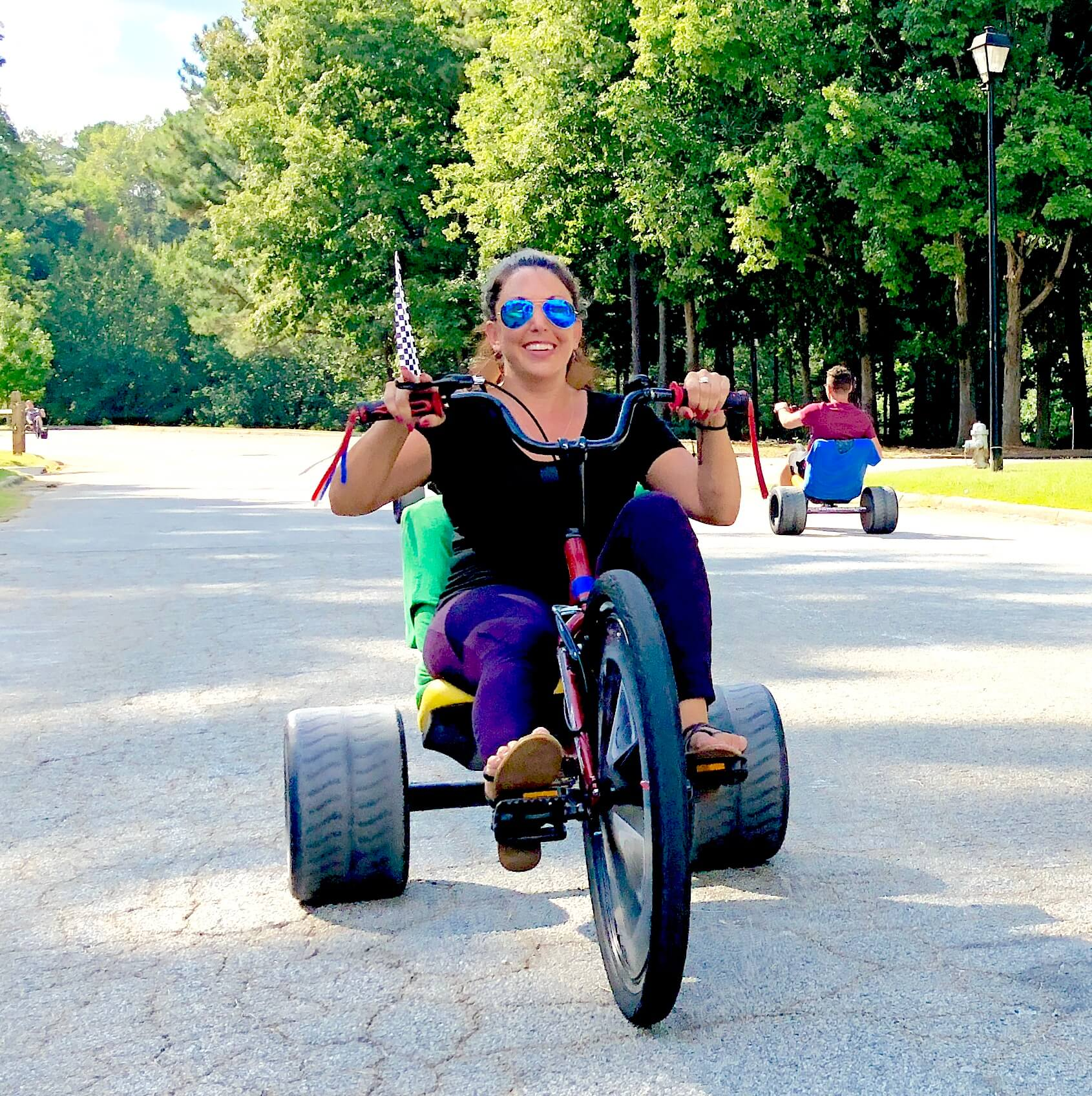 you have to smile on a Big Wheel , super fun team builder activity at Brookrun Park