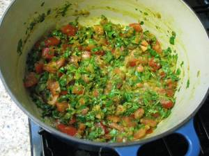 Tomatoes and cilantro added to mixture