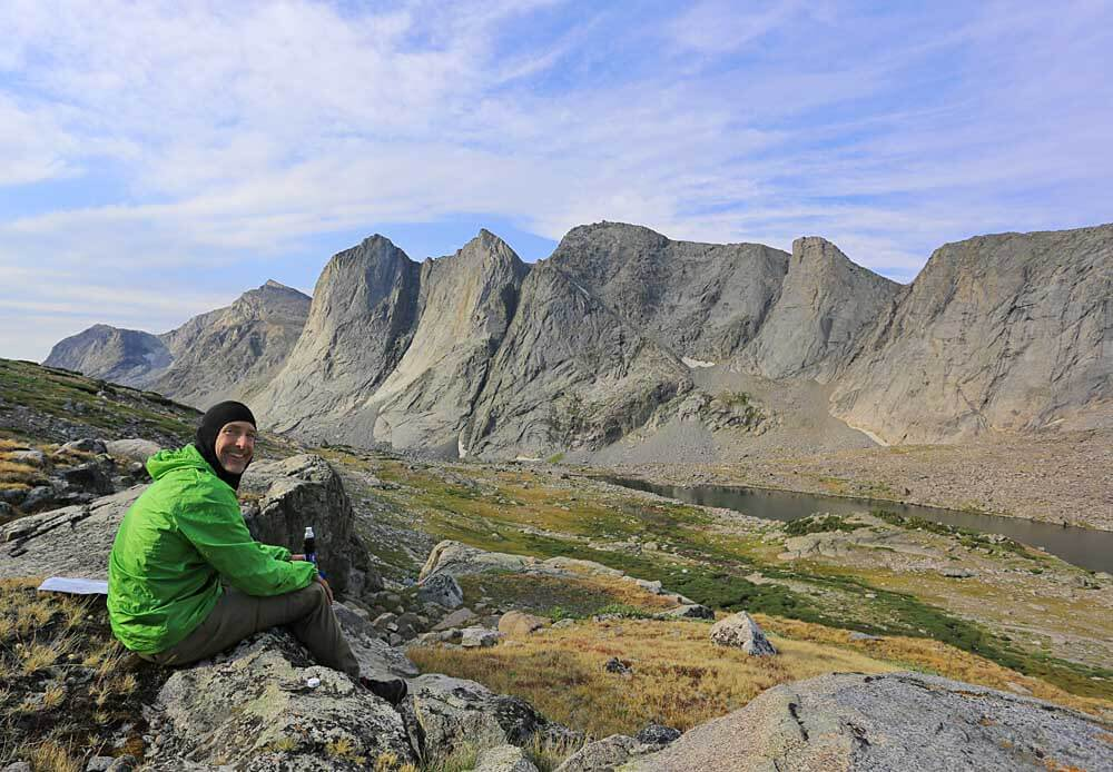 Early morning snack stop overlooking Lake 10,566 and the extensive ridgeline extending south from Raid Peak.