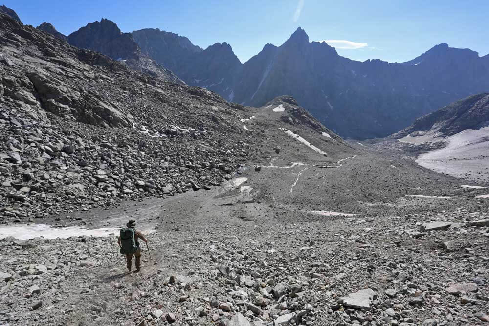 Alan descending from Knapsack Col, looking into the upper Titcomb Basin. The lower portion of the Twins Glacier can be seen on the right. Considerable ice lies hidden below the talus and made the lower portion of this descent more interesting than we expected.