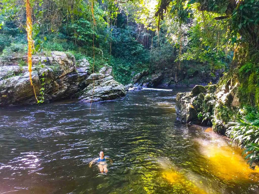 A refreshing swim in a jungle river after a hot and humid hike.
