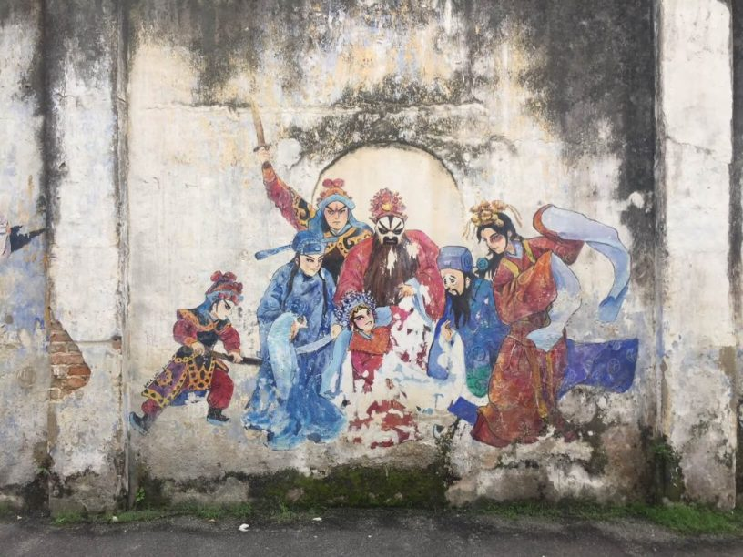 mural of costumed men