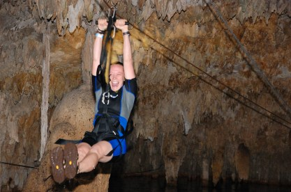 Zip-lining into a cenote.