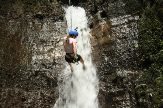 Rappelling down a smaller waterfall.
