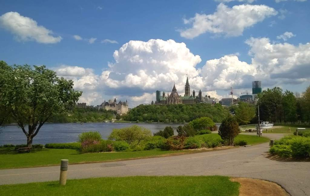 Biking by the Canadian Museum of History with views of the Ottawa River and Canadian Parliament.