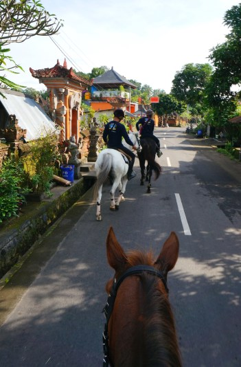 Riding through the village.