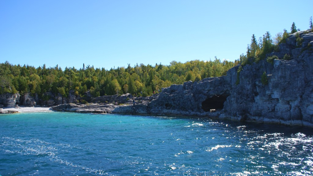 The beautiful clear blue waters near The Grotto.