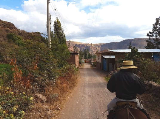 Riding through a small village near Urubamba.