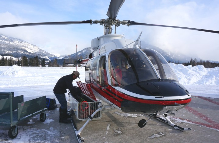 Loading the helicopter with our gear.