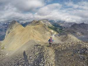 Hiking down a steep skree field from the top of Northover Ridge.