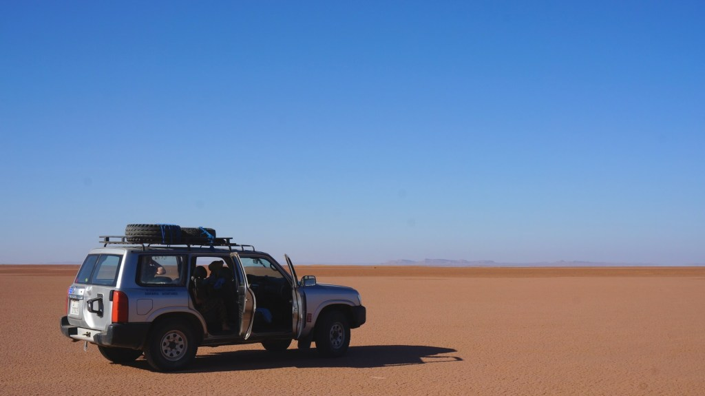 Driving across a dried up lake bed.