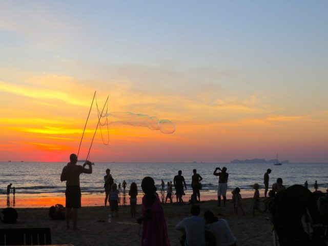 Kids playing on the beach with bubbles at Ko Lanta