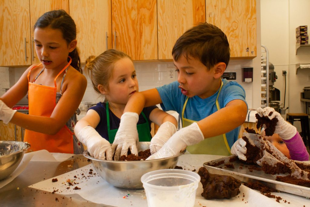 Camp Milk Bar kneading chocolate birthday dough