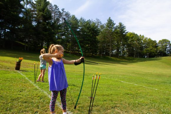 girl learning archery