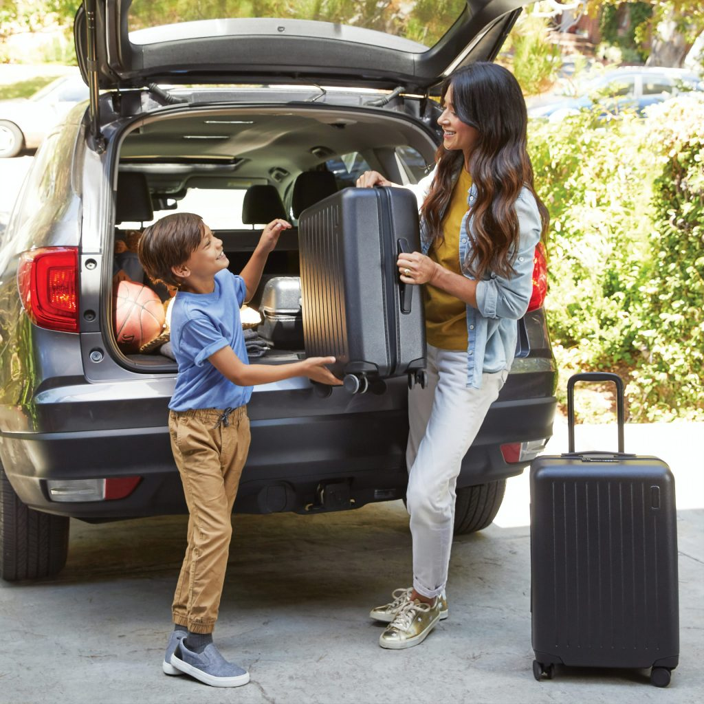 kid packing suitcase