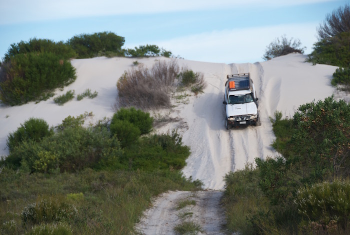 Graham drives down the dune.