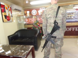 Soldier with an M16 in one of many coffee shops.