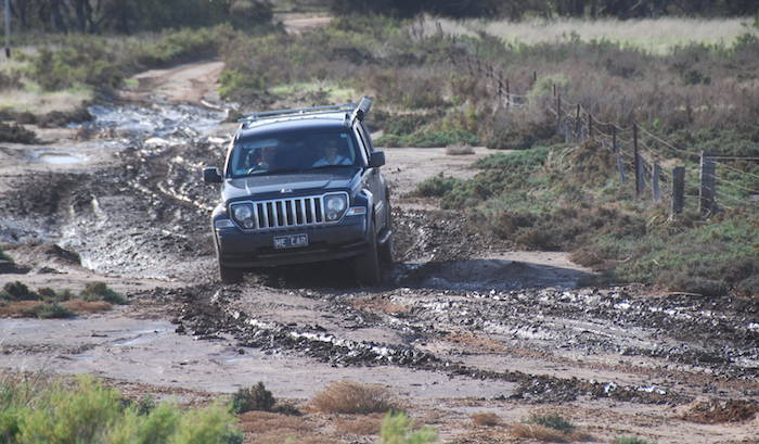Nick negotiates the mud in his Jeep.