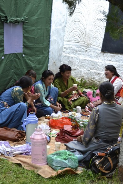 A group of young women chat over beer and yak butter tea during the yogurt festival in Lhasa