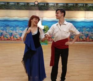 Ariel and Eric dance a sailors jig