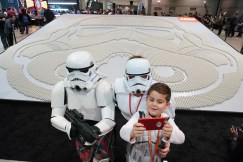 Star Wars†enthusiast Joseph Naiman, 7, takes a selfie with his parents Marshall, left, and Danelle next to the†largest†display of†LEGO†Star Wars†minifigures at†Star Wars†Celebration in Chicago, April 11, 2019. The display, which is made up of 36,440†LEGO stormtrooper minifigures, broke the GUINNESS WORLD RECORDS title. (Alex Garcia/AP Images for The†LEGO†Group) †