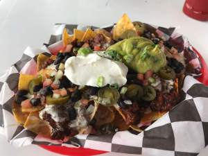 Nachos from the appetizer menu with spicy chili on top. mikel mays bob hall pier padre bali park best free beach corpus christi texas