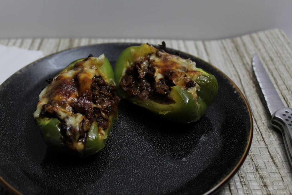 These Slow Cooker Philly Cheese Steak Stuffed Peppers are full of juicy flavor, warm melted cheese and tons of vegetables. Sure to be a hit in your home!