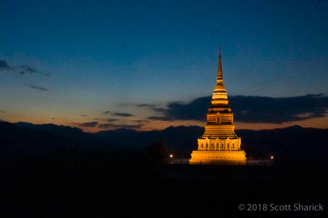 A sunset drone view of Wat Phrathat Mon Phrachao Lai in Northern Thailand