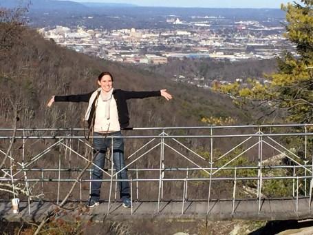 girl on suspension bridge in rock city