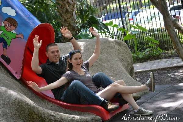 Story land in city park has us feeling like a kid again with this engagement photo idea! Check out our other cute couple photo ideas over at adventuresofb2.com
