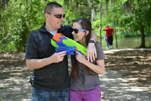so much fun having a water gun photoshoot- Make your engagement photos memorable with this fun water gun photoshoot idea! Perfect couple photo idea that makes for a great engagement photo idea! More over at adventuresofb2.com