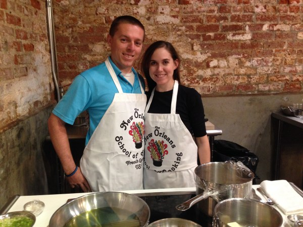 A couple enjoying date night at the new orleans school of cooking. Here the couple will learn how to cook a delicious New orleans style meal with a chef. - adventures of b2