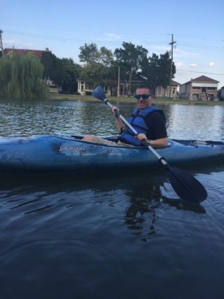 a man kayaking the bayou st john in new orleans