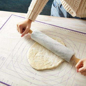 mat with dough being rolled out