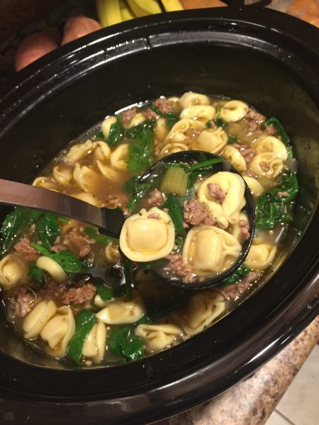Spinach, Sausage and Tortellini soup is an easy meal full of flavor that combines the savory taste of sausage with cheese tortellini and spinach for a wholesome and hearty meal. #soup #crockpotrecipe #easymeals