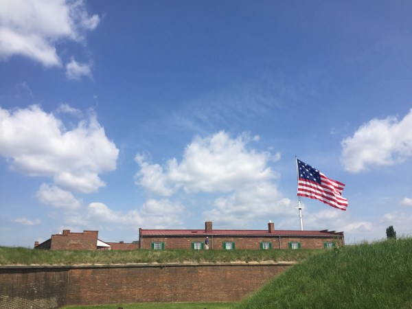 American flag flowing freely in Fort McHenry in Maryland.