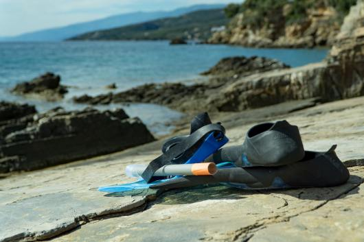 snorkeling with your partner is a great active date to burn some calories but stay cool this summer.