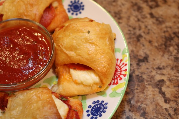 Spice up pizza night with these cute pizza pockets. Made with crescent rolls , cheese and your own toppings, these are a delicious change to a favorite meal.