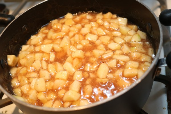 diced apple simmer in cinnamon to make a homemade apple pie filling for amazingly delicious apple pie cookies.