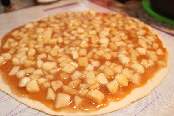 Delicious apple pie filling covering cookie crust. These apple pie cookies are to die for and make a perfect fall treat for parties.