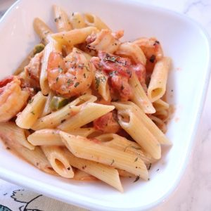 Cajun shrimp pasta made with green bell peppers, diced tomatoes and jumbo shrimp. A flavorful meal made in 30 minutes or less.