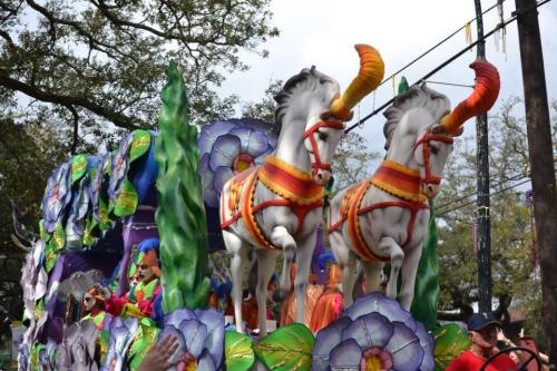 Parade float passes by as people wave to catch some goodies from the Mardi Gras float. If you've never been to Mardi Gras, your first trip can be overwhelming. Get all the best tips from a local to help make your first Mardi Gras a great experience. - Adventuresofb2